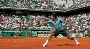 """Federer in the French Open...honestly, his shirt was the same shade of blue as Dad's. I don't care what he says about how he """"knows his shades"""" from sorting pieces at Mema's dress factory. Oye."""