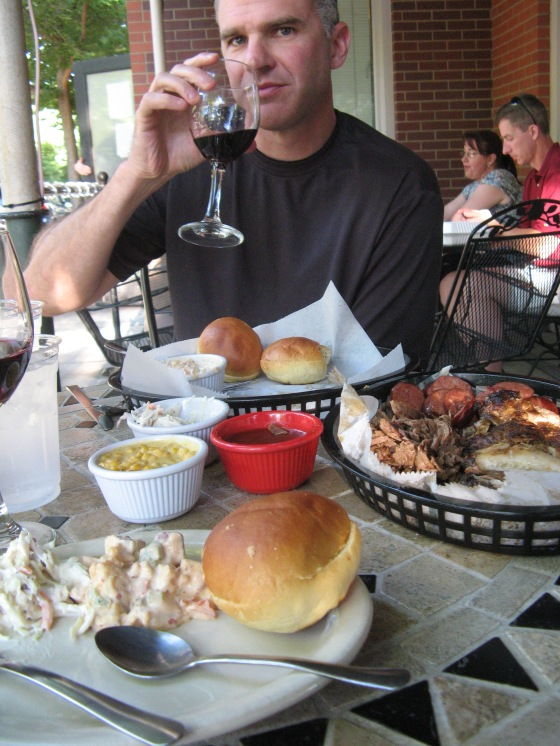 """As part of the recently instated """"new restaruants only"""" policy, we tried The Rib House in Longmont. There was a line out the door and I'm not surprised. The food was to die for. We may have to cancel the """"new only"""" policy so we can go back! We ordered ribs, beef brisket, smoked sausage, spicy potato salad, cole slaw, and this cheesy corn thing. Plus rolls and a bottle of red wine. It was gluttonous, delicious, perfectly situated on the patio in cool new Longmont neighborhood (which we strolled around after dinner). A perfect ending to a perfect day."""