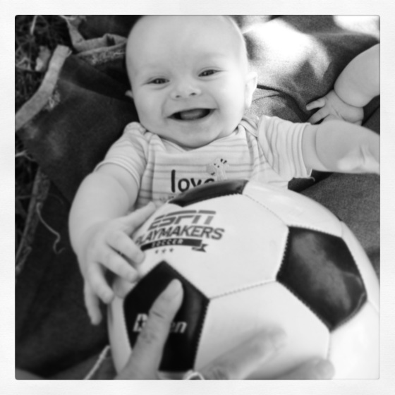 Future soccer star--clearly loves the game already!