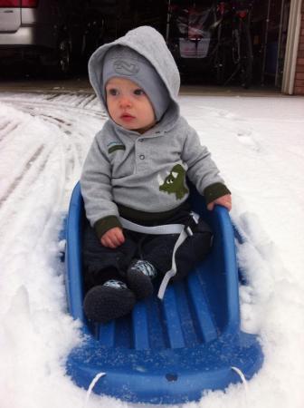 He loves sledding. Really he does.